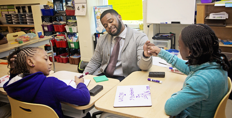 Mickey Bryant working with two students at Ketcham Elementary